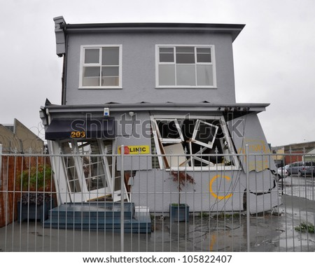 CHRISTCHURCH, NEW ZEALAND - MARCH 20: A house in the east of the city leans precariously on March 10, 2011 after a huge earthquake in Christchurch. - stock photo