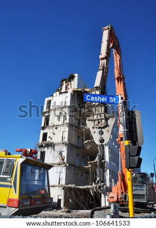 CHRISTCHURCH, NEW ZEALAND - MAY 20: Powerful equipment being used to tear down earthquake damaged high rise buildings on May 20, 2012 in Christchurch. - stock photo