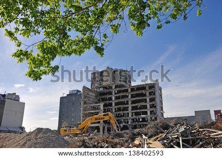 CHRISTCHURCH, NEW ZEALAND, NOVEMBER 16:  An excavator continues demolitions in earthquake ridden Christchurch, New Zealand on 16-11-2012. - stock photo