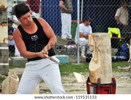 CHRISTCHURCH, NEW ZEALAND - NOVEMBER 16: Competitor in the Overhand  Wood Chopping event at the 2012 Canterbury A&P Show on November 16, 2012 in Christchurch. - stock photo