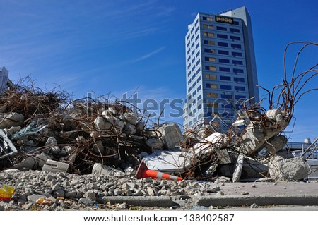 CHRISTCHURCH, NEW ZEALAND, NOVEMBER 16: Piles of earthquake rubble lay untended in Christchurch, New Zealand on 16-11-2012. 182 people died in the 6.4 earthquake the previous year. - stock photo