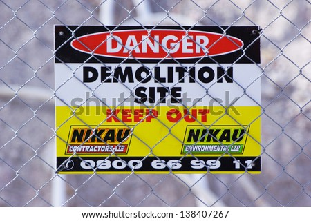 CHRISTCHURCH, NEW ZEALAND, NOVEMBER 16 - Signage warns people to keep out of demolition area in Christchurch, New Zealand on 16-11-2012 . 182 people died in the 6.4 earthquake the previous year. - stock photo