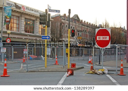 CHRISTCHURCH, NEW ZEALAND, SEPTEMBER 22, 2011 - fencing remain around the earthquake damaged red zone in Christchurch city, South Island, New Zealand. 22-09-2011. - stock photo