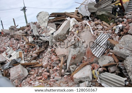CHRISTCHURCH, NEW ZEALAND, SEPTEMBER 4, 2010  -  Rubble piled up from buildings destroyed in the 7.1 magnitude earthquake in Christchurch, South Island, New Zealand, 4-9-2010 - stock photo