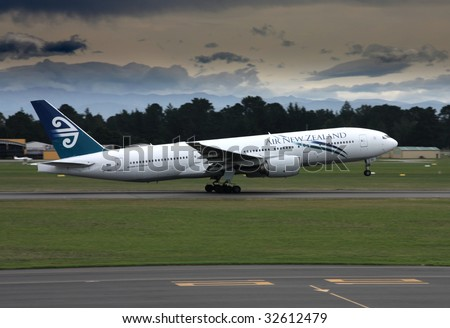 CHRISTCHURCH, NZ - MARCH 17: Air New Zealand Boeing 777 taking off from Christchurch Airport on March 18, 2009. The B777 series is notable for safety. No fatal accidents with this aircraft ever happened. - stock photo