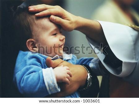 christening ceremony in Catholic church - stock photo