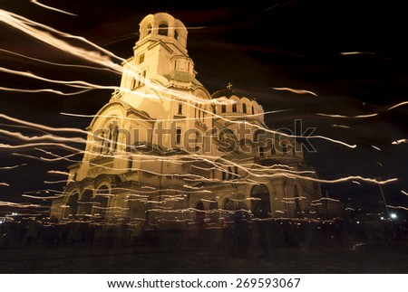 Christian believers are traditionaly circling with candles Aleksander Nevsky cathedral on Easter night in Sofia, Bulgaria. - stock photo
