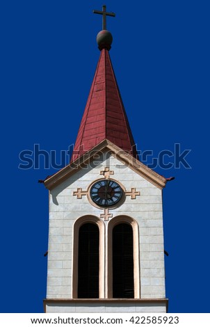 Christian church steeple with cross and clock  - stock photo
