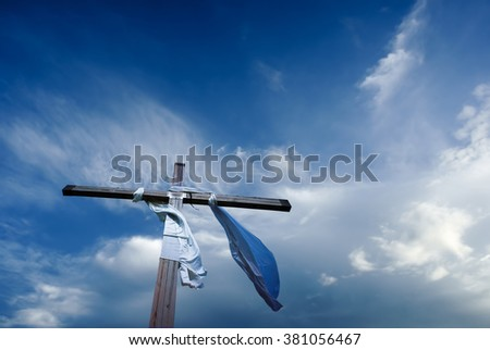 Christian cross against beautiful blue cloudy sky - stock photo
