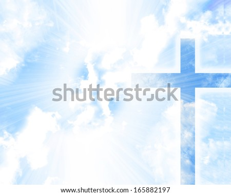 christian cross in a blue sky with some clouds - stock photo