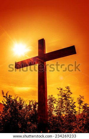 Christian cross in a rays of sun. - stock photo