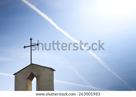 Christian cross in blue background whit copy space - concept image - stock photo