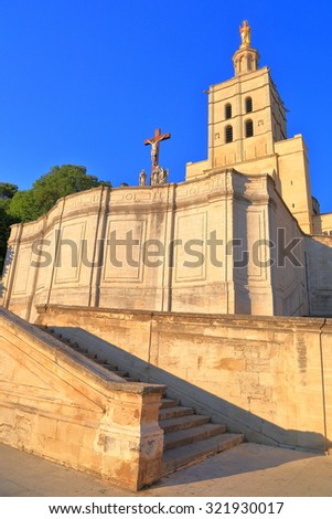 Christian cross in front of the Avignon Cathedral, Provence, France - stock photo