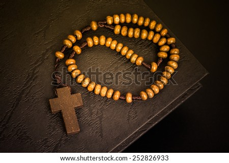 Christian cross necklace on Holy Bible book, Jesus religion concept as good Friday or Easter festival background - stock photo