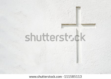 Christian cross on building wall. All white and space for text on the left part of the picture. - stock photo