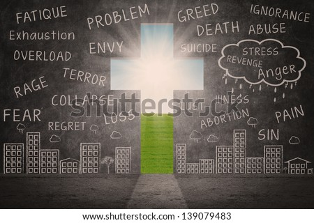 Christian cross sign with blackboard writing and view of sunlight outside - stock photo