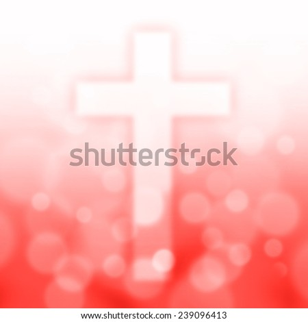 christian cross with bokeh light background,red color tone - stock photo