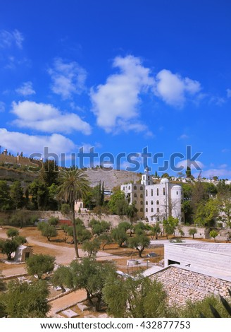 Christian monastery in Jerusalem, Israel. Beautiful bell tower surmounted by a cross - stock photo