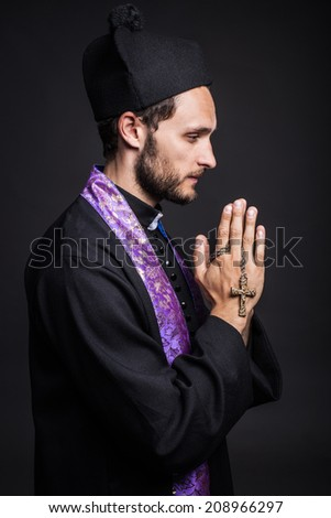 Christian priest is praying - stock photo