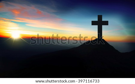 Christianity concept with christian cross silhouette on the hill on sunset - stock photo