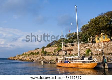 Christianso Island harbor with yacht - stock photo