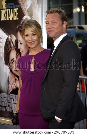 Christina Applegate and Martyn LeNoble at the Los Angeles premiere of 'Going The Distance' held at the Grauman's Chinese Theater in Hollywood on August 23, 2010.   - stock photo