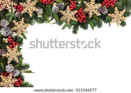 Christmas abstract background border with gold snowflake bauble decorations, holly, ivy, mistletoe, pine cones and blue spruce fir over white. - stock photo