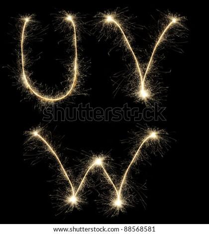 Christmas alphabet  created a sparkler - stock photo