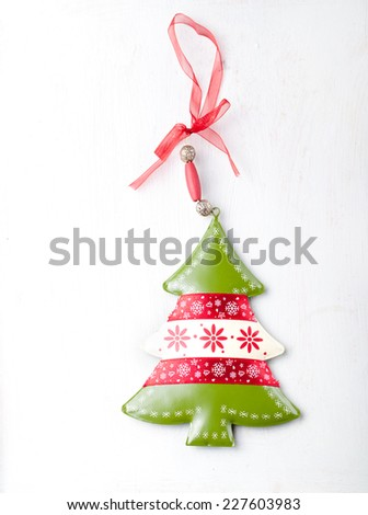 Christmas and New Year background. Christmas tree  on a white wooden background. Copy space. - stock photo