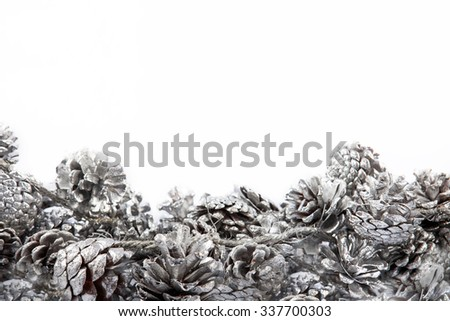 Christmas and New year background with pinecones decoration on white - stock photo
