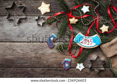 Christmas and New Year 2015 decorated cookies in rustic style on wood. Free space for text - stock photo