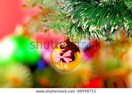 Christmas and New Year decoration-balls on fir tree - stock photo