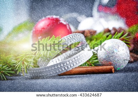 Christmas and new year decoration on black wooden background - stock photo