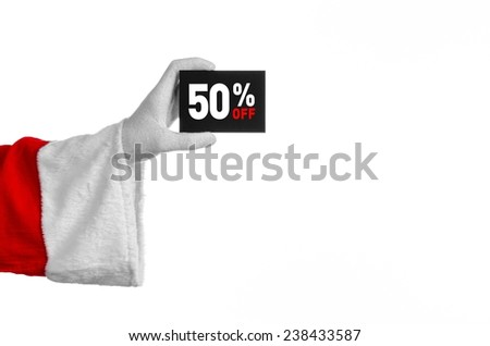 Christmas and New Year discounts topic: Santa's hand holding a black card with a 50 percent discount on an isolated white background - stock photo