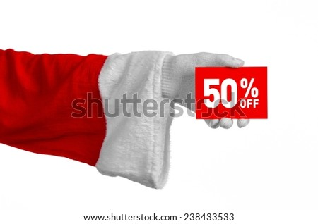 Christmas and New Year discounts topic: Santa's hand holding a red card for a 50 percent  discount on an isolated white background - stock photo