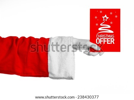 Christmas and New Year discounts topic: Santa's hand holding a red card with a Christmas discount on an isolated white background - stock photo