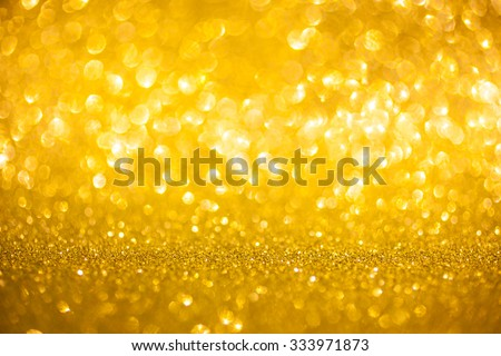 Christmas and New Year feast bokeh background. Golden holiday glowing abstract glitter defocused background with blinking stars. Blurred bokeh - stock photo