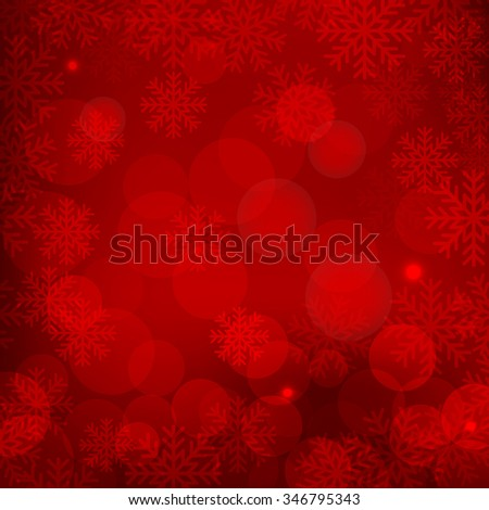 Christmas and New Year holidays red background bokeh effect with defocused lights and snowflakes - stock photo