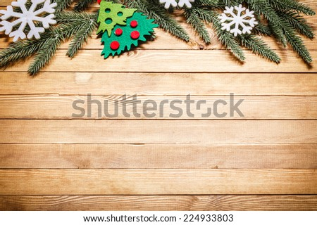 Christmas and New Year's attributes on the wooden background with space for text greetings. - stock photo
