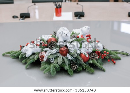 Christmas and New Year's flowers composition in the business center and in the office. - stock photo