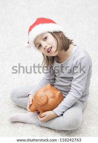 christmas and piggy bank - concept - stock photo