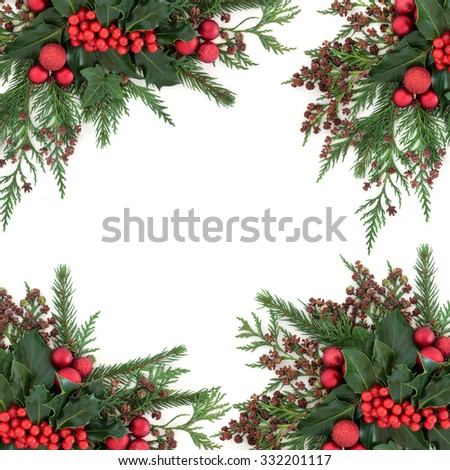 Christmas and winter flora with red bauble decorations, holly, ivy, fir and cedar cypress over white background. - stock photo