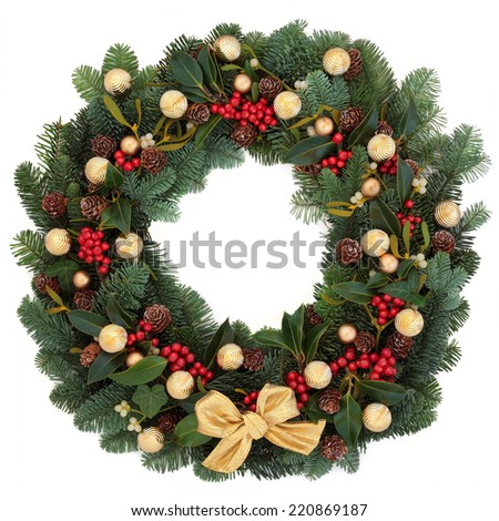 Christmas and winter wreath with gold bauble decorations,holly, ivy, mistletoe, spruce fir and pine cones over white background. - stock photo