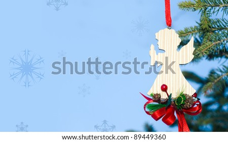 Christmas angel for card on the blue background having much copy space - stock photo