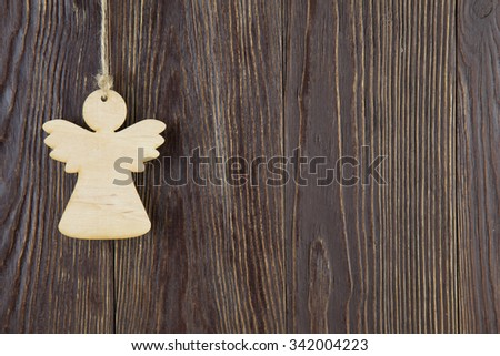 Christmas angel  on old wooden background - stock photo