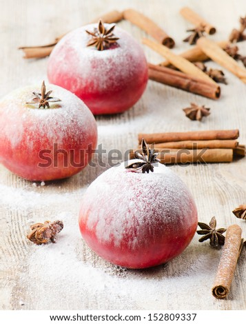 Christmas apples and spices on  wooden table.Selective focus - stock photo