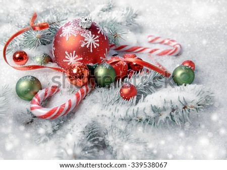 Christmas arrangement in red and green on christmas tree twigs under snow. Merry Christmas! - stock photo