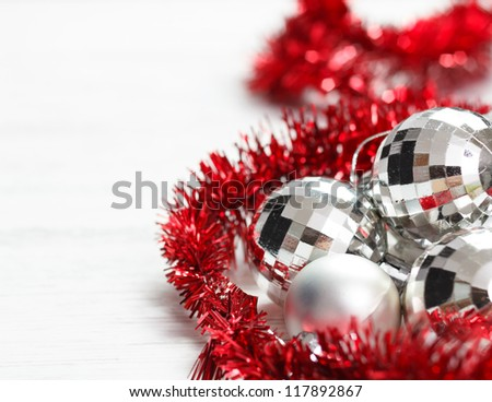 Christmas arrangement with silver baubles and red garland.Copy space on left. - stock photo