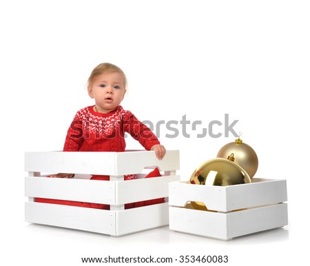 Christmas baby child in santa hat hold gold ball decoration. New Year 2016 holiday concept isolated on a white background - stock photo