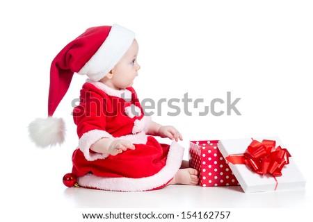 christmas baby girl opening gift box isolated on white background - stock photo